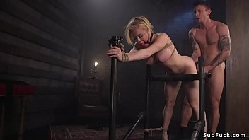 Gagged busty sub is tied and anal banged