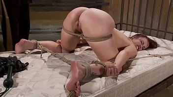 Tied up sub fingered by her master while bound on bed