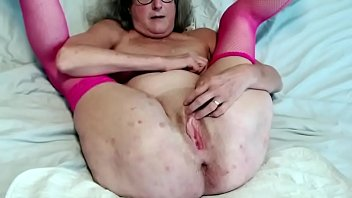 60 year old granny spreads her twat wide and gets wet fingering