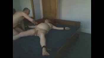 Using my submissive old slut tied on bed. Amateur
