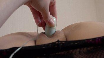 Masturbate clitoris The girl in pantyhose masturbates her clitoris with a vibrator