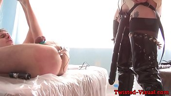 Busty femdom toying her cbt subjects ass