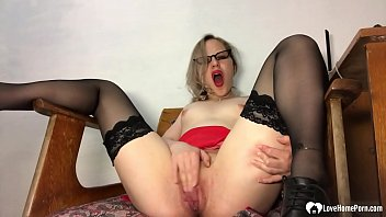 Kinky secretary in stockings pleasures her juicy cunt