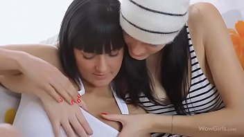 Two Brunettes Share A Dildo On The Couch - see  full video here http://zo.ee/6CBx1
