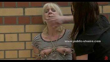 Blondie slut gets boobs out in public image