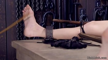 Gagged brunette tormented in device bondage