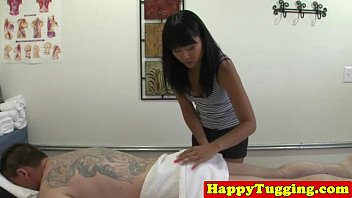Asian handjob masseuse tugging hard cock