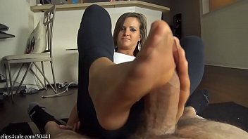 Girlfriend gives nylon footjob to her boyfriend