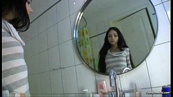 Beautiful teenager in the bathroom