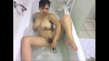Big Titted Latina Plays with Her Toy in soapy bathtub -tinycam.org