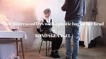 Tied Mistress suffers with a plastic bag on her head