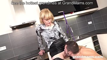 Blonde granny fucks young boy in the kitchen thumbnail
