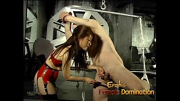 Tied-up and gagged stud has his cock pleasured by an Asian bimbo