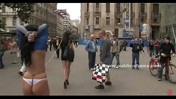 Curly sexy brunette on high heels and with very short skirt served in public sex