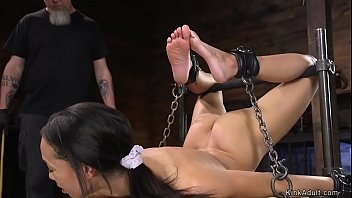 Ebony slave in back bend bondage