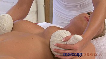 Massage Rooms Lola slides her oily fingers inside two horny teens