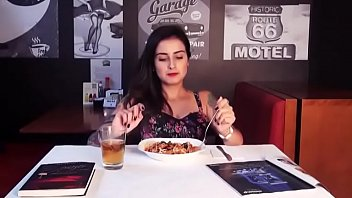 Hot girl having good time in restaurant