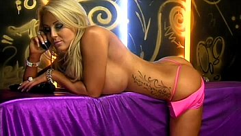 Hot busty blonde telephone sex girl in pink dress