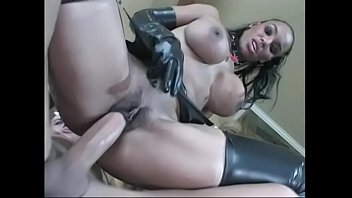 Black woman with big breasts dresses in latex