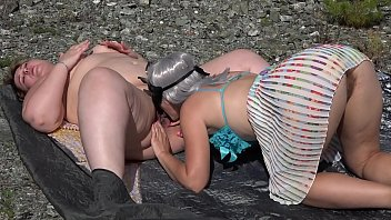 Lesbian washed her fat girlfriend's pussy and licking her. Oral caresses with cunnilingus outdoors.