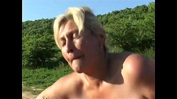 Guy fucks horny old blonde in mud outdoors