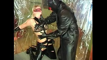 Man in fetish mask bangs the ass of a dirty girl