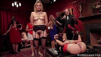 Tied slaves sharing dick at bdsm party