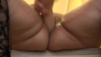 BBW with a big ass masturbates on the stairs, a huge dildo in fat pussy to orgasm.