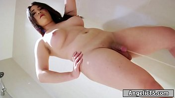 Busty asian shemale Kim C jerking off cock and takes a leak porn image