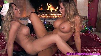 Pierced busty lesbian scissors at fireplace