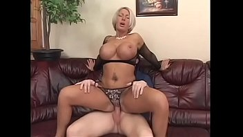 Big fake tits MILF Andrea in fishnets seduces young man to bang her