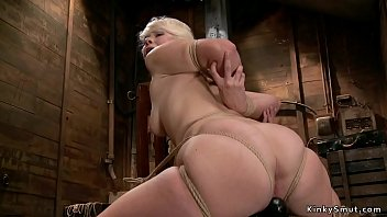 Blonde in tights gets crotch rope