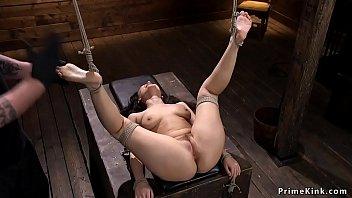 Hogtied brunette gets spanked in dungeon