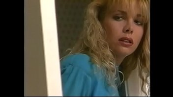 Naughty blonde Stephanie DuValle in blue dress is fond of watching furtively nympho Nikki Shane playing in the bathroom with Stephanie's friend