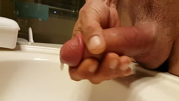 Penis ejaculator Stroking pumped penis