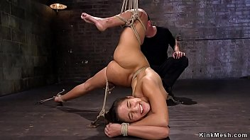 Brunette in extreme hogtie vibrated