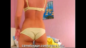 Sexy blonde showing full length of her perfect legs and undressing on cam