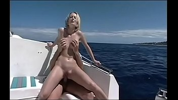 Sexy blonde fucking on the boat while her brunette girlfriend takes a cock on the coast