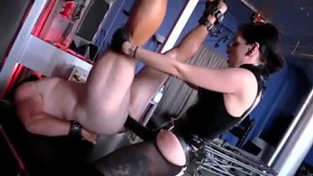 Mistress fucking slave with monster strapon