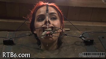 Slaver is torturing babe'_s cunt