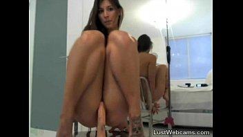Cute brunette rides dildo on webcam