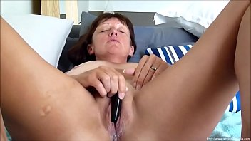 Cute Cougar Masturbating WithA Vibrator In Front Of Her Partner