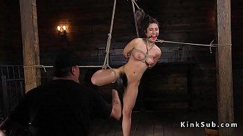 Restrained and hogtied slave tormented