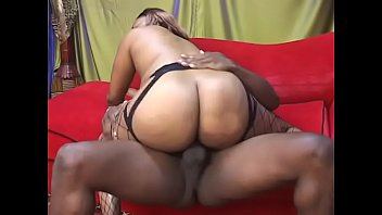Big black ass in fishnets bounces her pussy on hard cock cowgirl style