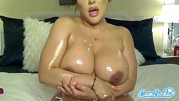 Kiara Mia oils her big titties and ass before masturbating.