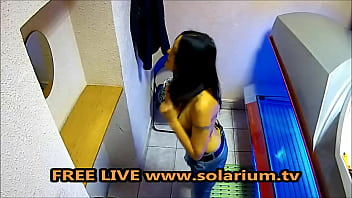 Solarium Horny Milf with big breasts masturbates under the solarium