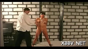 Standing up naked - Naked wife stands tied up and endures heavy breast thraldom