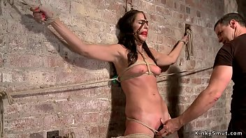 Gagged and restrained brunette whipped