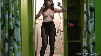 Japanese fishnet girl undressing hidden cam at the bathroom