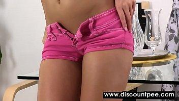 Slim girl in shorts masturbates and pees